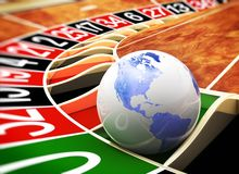The world is a casino. Casino roulette ball with world map Stock Photo