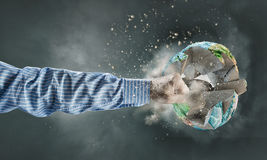 World catastrophe. Human hand strikes planet earth. Elements of this image are furnished by NASA Stock Photos