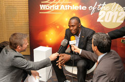 Usain Bolt interviewed. World champion athlete Usain Bolt interviewed by tv channel Eurosport during a Centenary of IAAF at Hotel pullman on November 24, 2012 in Stock Image