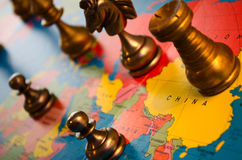 Chess pieces on map. Closeup of chess pieces on a world map Stock Photos