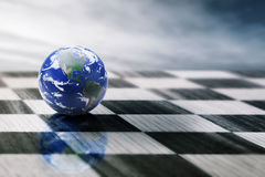 World on a chessboard  on blue sky background. Elements of this image furnished by NASA Stock Photography
