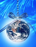 World Christmas Globe Earth. The earth as a christmas ornament  with sky, stars and tree in the background Stock Photography