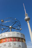 World Clock and television tower in Berlin. The famous world clock (Weltzeituhr) on Alexanderplatz square in Berlin with the tv tower (Fernsehturm) in the Stock Photo