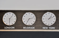 World clocks. In the hole of big shopping mall royalty free stock images