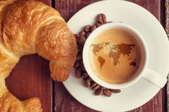 World of coffee. Coffee with a world map and croissant stock photos
