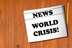 World Crisis Concept. Newspaper and yellow pencil on wooden background Royalty Free Stock Photography