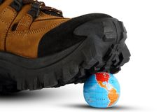 World crushed by a shoe - conceptual image Royalty Free Stock Photo