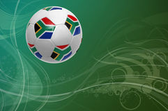 World cup 2010. Illustration of a South African world cup soccer ball over a soft blue to green background Royalty Free Stock Photos