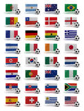 World Cup 2010. Soccer World Cup 2010 participating countries - complete set of flags and soccer balls of all competing nations Stock Photo