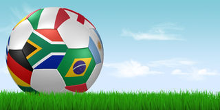 World cup 2010 soccer ball in grass. 3d render/illustration of a soccer ball with national flags lying in grass - south african flag in front Stock Photos