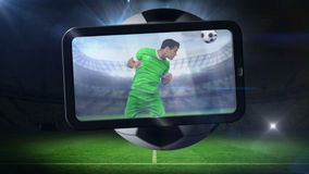World cup animation with tablet screen showing player Stock Photos