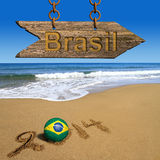 World cup. Brasil written on the wooden sign, 2014 on the beach Royalty Free Stock Photos
