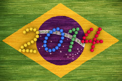 World Cup 2014. 3D rendering of footballs form in to the year 2014 over a Brazil flag painted on a wood floor Royalty Free Stock Photo