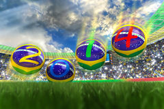World Cup 2014. 3D rendering of footballs in the year 2014 in a football stadium Stock Image