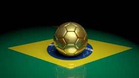 World cup. Gold soccer ball on Brazilian flag Stock Photography