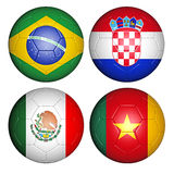 World cup 2014 group A. Brazil world cup 2014 group A flags on soccer balls Royalty Free Stock Photos