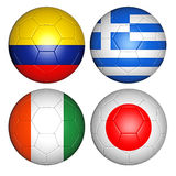 World cup 2014 group C. Brazil world cup 2014 group C flags on soccer balls Royalty Free Stock Photos
