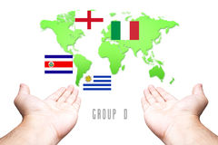 World Cup 2014 Group-D Flag with Hand and World Map background. Group-D Flag with Hand and World Map background Stock Photos