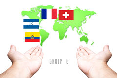 World Cup 2014 Group-E Flag with Hand and World Map background. Group-E Flag with Hand and World Map background Stock Image
