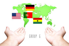 World Cup 2014 Group-G Flag with Hand and World Map background. Group-G Flag with Hand and World Map background Royalty Free Stock Photography