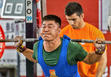 The 2014 world Cup powerlifting AWPC in Moscow. Moscow, Russia - August 22, 2014: Unidentified athlete in action during the 2014 world Cup powerlifting event in Royalty Free Stock Image