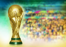 World Cup shining and stadium. FIFA World Cup Trophy shinning on multicolor faded stadium background Stock Photo