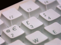 World currencies. Macro of a computer keyboard showing the symbols of dominating western currencies Stock Photo