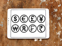 World currencies icons like dollar and euro. Vectors and icons of most famous global currencies like dollar, euro, pound, yen, franc on white tablet holded on Stock Photo