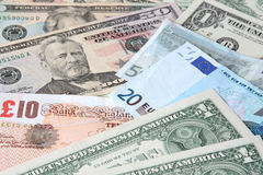 World currencies: U.S. dollars, pounds and euros. Banknotes Stock Photography