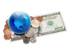 World currency. Globe view to North America on dollar coins and banknote. Focus on globe Stock Images