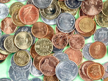 World currency coins. Coins of many currencies, mostly uncirculated. Different metals Stock Images
