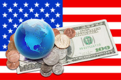 World currency - globe with money over USA banner. World currency. Globe view to North America on dollar coins and banknote. Focus on globe Stock Image