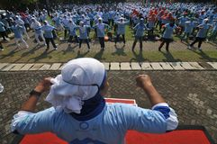 World Diabetes Day in Indonesia. SURAKARTA, INDONESIA - November 16 : A women perform healthy gymnastics during the commemoration of World Diabetes Day in royalty free stock image