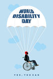 World Disabilities day. Man in  wheelchair goes down on parachut. E. Disabled in protective helmet flies. Yes, you can. Poster for international Day of Disabled Royalty Free Stock Photo