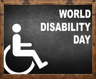 World disability day written on blackboard royalty free stock images