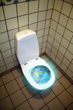 World down the toilet Royalty Free Stock Photo