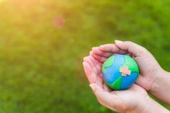 World Earth Day concept. Woman hand holding handmade globe Stock Photography