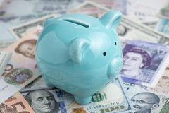 World economic, investment and saving with blue piggy bank on in royalty free stock photo