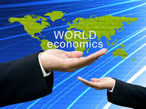 World economics concept on hand Royalty Free Stock Photos