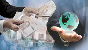 World economics concept. Thai money in hand royalty free stock photo