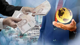 World economics concept. Thai money in hand stock photography