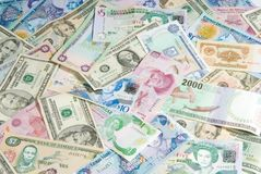 World Economy. Money from Different Countries depicting a Global/World Economy. Money from Belize, Bermuda, Grand Cayman, Costa Rica, Jamaica, Mexico, Slovakia Royalty Free Stock Photo
