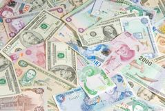 World Economy. Money from Different Countries depicting a Global/World Economy. Money from Belize, Bermuda, Grand Cayman, Costa Rica, Jamaica, Mexico, Slovakia Royalty Free Stock Photos