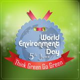 World environment day concept grey label with red ribbon on green background Royalty Free Stock Images