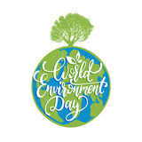 World environment day hand lettering for cards, posters etc. Vector calligraphy with tree on Earth globe background. Stock Image