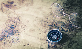 World Explorer equipment with compass on vintage map Stock Image