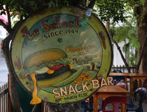 World famous bar Le Select in Gustavia Harbor, St. Barts. ST BARTS, FRENCH WEST INDIES - JUNE 11, 2015: World famous bar Le Select in Gustavia Harbor. The island Royalty Free Stock Photos
