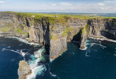 World famous birds eye aerial drone view of the Cliffs of Moher in County Clare, Ireland. Beautiful Irish Countryside Landscape on the Wild Atlantic Way route Royalty Free Stock Photos