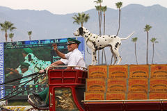World-Famous Budweiser Clydesdale Beer Wagon. ARCADIA, CA - DEC 26: Drivers of the Clydesdale-drawn Budweiser Beer Wagon wave to fans at Santa Anita Park during Royalty Free Stock Photography