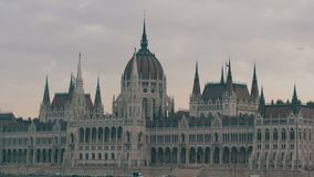 The world-famous building of the Hungarian Parliament in Budapest in the Gothic style in cloudy weather. The world-famous building of the Hungarian Parliament stock footage
